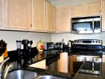 Kitchen with micro-wave, stove, dishwasher, coffee maker, toaster.
