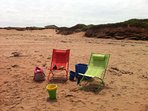 Cottage beach chairs and sand toys.
