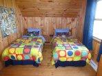 2nd floor kids bedroom with 2 new twin beds, dresser and activities chest.