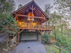 Experience a peaceful woodland getaway at 'The Golden Retreat,' a 3-bedroom, 3-bathroom vacation rental cabin in...