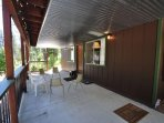 Covered deck, first floor. View 2. Bigfoot Cabin Unit 4 Lot 281 Pine Mountain Lake Vacation Rental Near Yosemite...