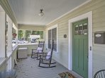 Sip morning coffee on the front porch when you stay at this 3-bedroom, 2-bathroom vacation rental cottage in Mount Dora.