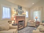 This sitting area features couch seating and an exposed brick gas fireplace.