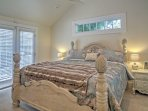 Retreat to the master bedroom with king bed.