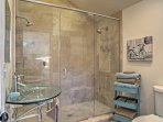 This en-suite bathroom features a large walk-in shower with glass enclosure.