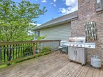 Step out onto the back deck and gaze out upon the large backyard which is lined with over 50 apple trees.