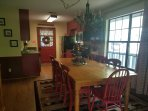 Large dining table that comfortably seats 8. Perfect place for the family to start and end their day
