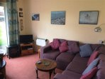 Lounge with coffee table and Freeview TV