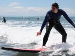 Learn to surf on a local beach.