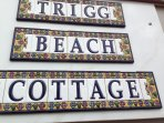 Trigg Beach Cottage sign on front of house