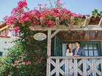 Bride and Groom Standing on Patio of Guest House #137