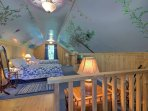 Upstairs, the colorful, painted bedroom features 2 queen-sized beds.