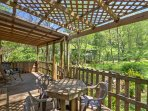 Enjoy an al fresco meal surrounded by greenery on the partly covered back deck.