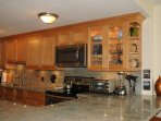 New gourmet kitchen with Caribbean Green Granite, stainless steel appliances, jumbo washer/dryer