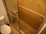 The master bathroom has a walk-in shower