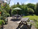 Family garden and patio with variety of chairs, tables, loungers, BBQ etc,