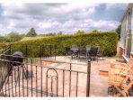 The large patio with table  and chairs for 8 people is  the perfect place for a BBQ