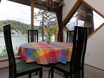 Dining room seats up to 6 for a spectacular lake view setting