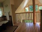 loft bedroom  has cast iron tub