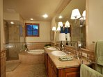 Top-floor master bathroom with shower and jetted spa