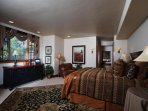 Master suite with king-size bed on the main floor