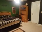 Townhome suite 1 bedroom with queen bed and attached private bathroom.
