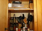 Plenty of cooking utensils, cutting boards, electric wine opener, air tight containers, knives, etc.