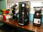 Coffee and Tea Center complete with electric coffee bean grinder, coffee pot, and 4-cup espresso!