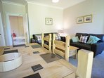Lounge with dining area, large flat screen television and free unlimited WI-FI. Double sofa-bed