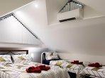 Upstairs 5 x 5 M family bedroom: 1 queen, 2 singles, 1 cot