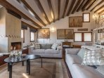 the living room is decorated with beautiful paintings and a collection of precious Murano Glass item