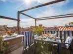 on the Altana (wooden roof top terrace) there is a table for 6 people