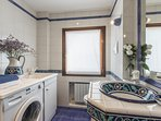 third bathroom with shower and washing machine