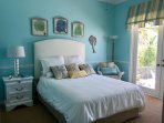 Spa bdrm (Q) with walk out to coquina pool deck.  Also has shared full ensuite and sisel rug.