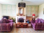 Bright & airy lounge w/ settee, armchair , TV w/english satellite channels