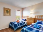 Upstairs twin bedroom with good size wardrobe and shared en-suite with single room.