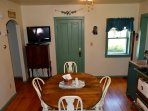Dining room with HD TV with over Direct TV 200 channels