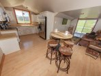 Kitchenette, dining area and main living space in guest house.