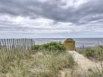 The cottage is just steps from the sandy shores.