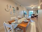 Enjoy your favorite home-cooked meals at this spacious dining table when you're not taking advantage of the numerous...