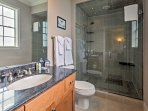 The stunning master bedroom features a large glass shower and stunning countertops!
