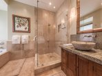 Master bath with shower and jet tub.