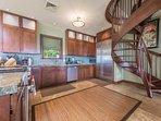 Spacious kitchen. Stairs that lead you up to the 5th bedroom/office.