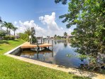 This beautiful Gulf-access, pool home is situated on an over sized corner lot on the Capri Canal.