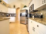 The fully equipped kitchen features stainless steel appliances, granite countertops, a breakfast bar and plenty of...