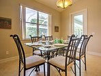 Share meals at the glass dining table set for 6.