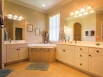 The master bedroom has an en suite bathroom with a luxurious bath tub.