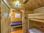 The bedroom includes twin-over-twin bunk beds.