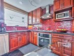 This fully equipped kitchen includes modern stainless steel appliances and an eye-catching tile back splash.