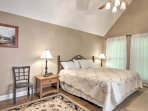 The master bedroom features a king-sized bed and en suite bathroom.